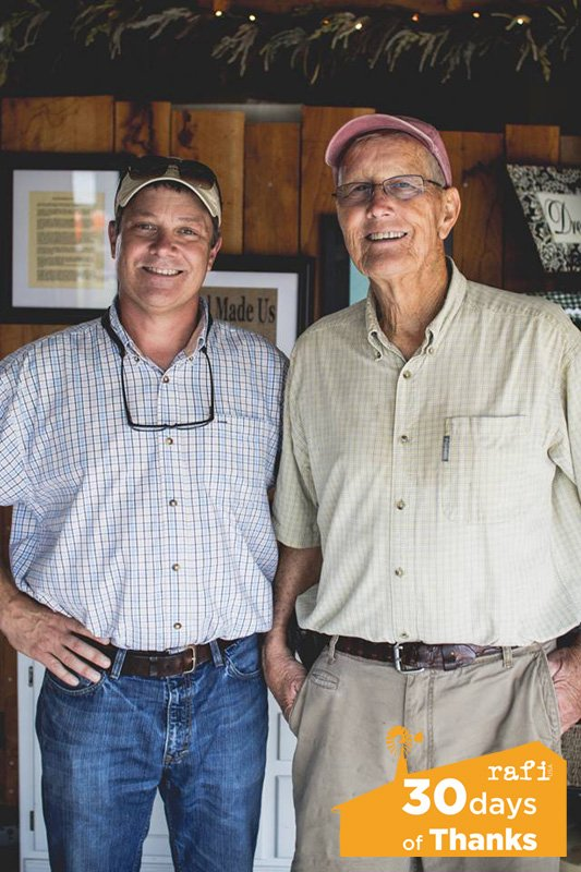 Russ Vollmer (left) and father John Vollmer of Vollmer Farm. Photo by Brandon Yow.