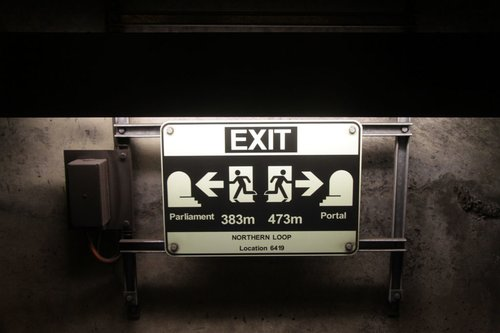Glow in the dark emergency exit signage in the Northern Loop between Parliament station and the portal