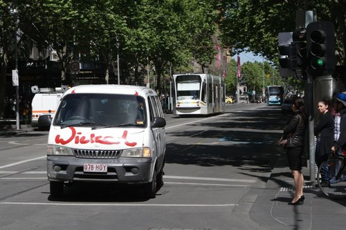 Tourists driving a Wicked Campervan turn from Swanston Street into the Bourke Street Mall