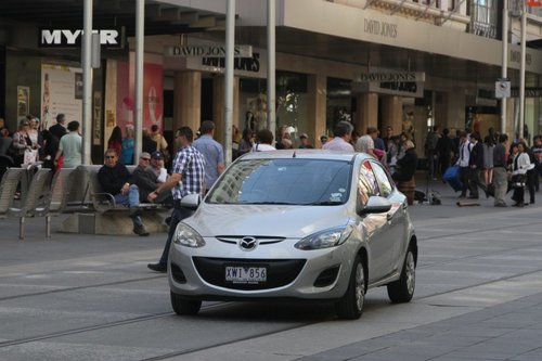 And now a third car - they followed the truck down the Bourke Street Mall