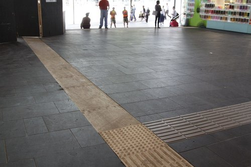 Tactile paving ripped up on the Collins Street upper level, replaced by plywood