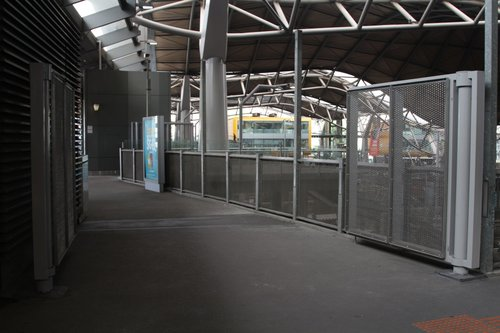 Gates between the V/Line and Metro platforms at the Bourke Street end of Southern Cross are now open