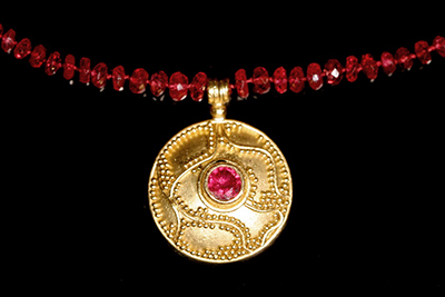 22k gold granulated pendant with ruby