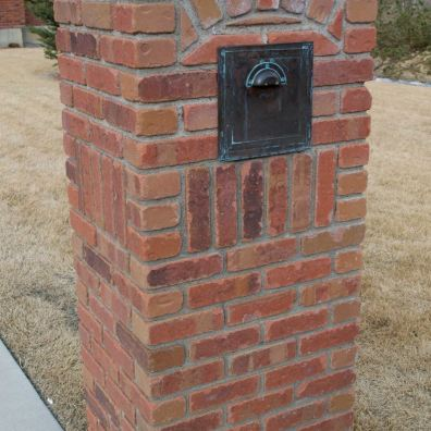 A brick mailbox.