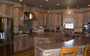 Alder kitchen with polished concrete countertops.