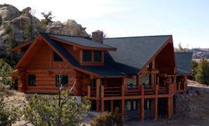 One way to do a log shed-dormer.