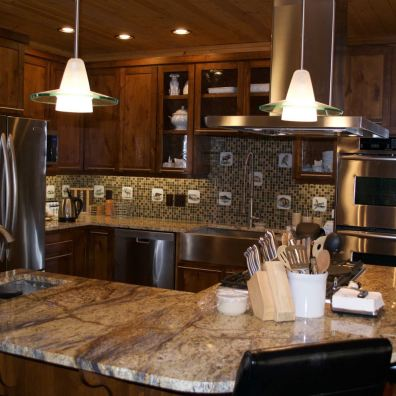 Kitchen with granite, glass tile and designer lighting.