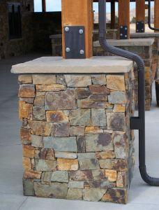 Custom, weight-bearing, stone-veneered support piers.