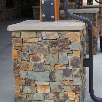 Custom, weight-bearing, stone-veneered support piers.