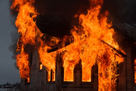 Flames from a house fire during a controlled burn
