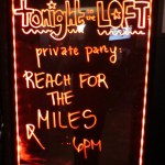 Reach for the Miles Sign