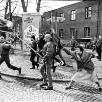 A woman hitting a neo-Nazi with her handbag, 1985