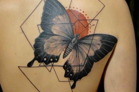 tattoo artist xoil combines a erfly with graphic designs to create this artistic abstract tattoo design