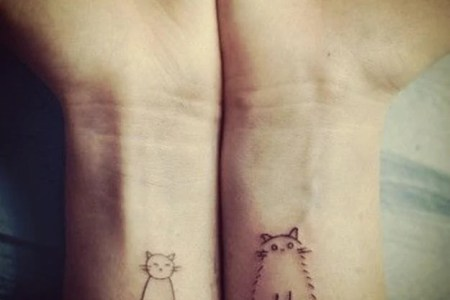 two cute simple drawings of cats become fun wrist tattoos