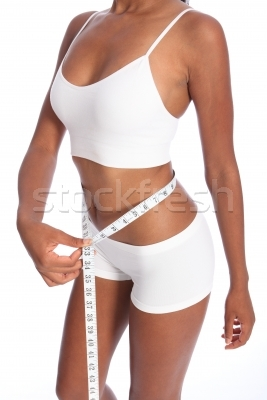 1282386_stock-photo-fit-torso-of-black-woman-checking-diet-weight-loss
