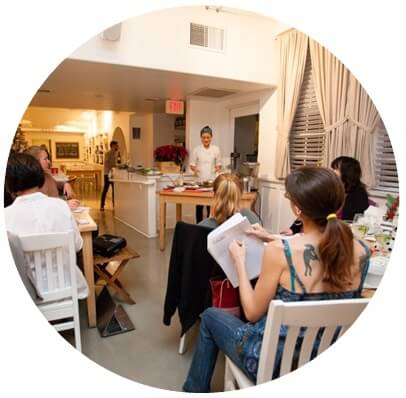 Image of clients at Real Healing Kitchen learning about cooking