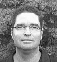 author John E. Schneider