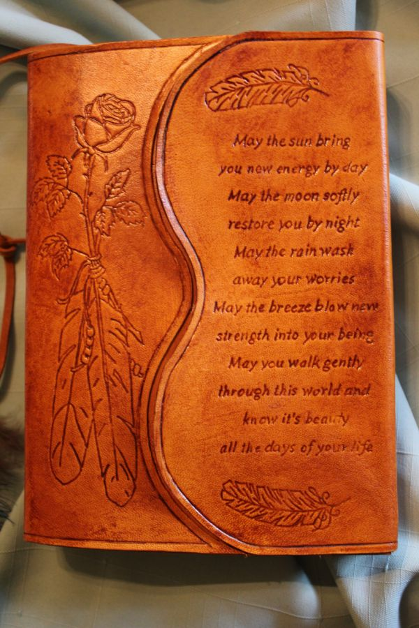 A rose with a feather is tooled into the front (symbolizing love and peace).  On the fold-over I tooled the Apache prayer.