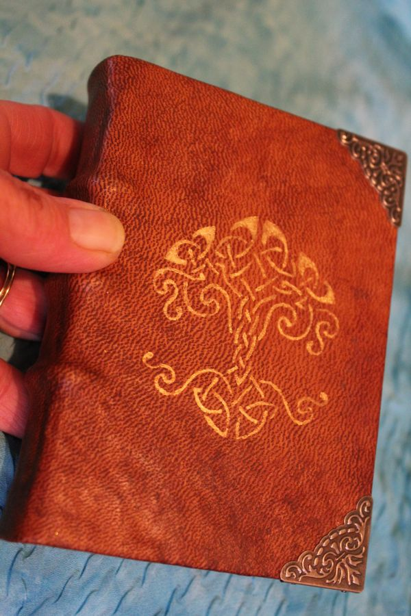 Tree of life hand painted onto the cover using metallic acrylic paint.