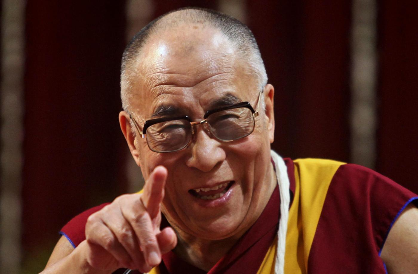 "FILE - In this Feb. 18, 2011 file photo, Tibetan spiritual leader the Dalai Lama gestures as he addresses the Mumbai University students in Mumbai, India. The Dalai Lama said Thursday, March 10, 2011, that he will give up his political role in Tibet's government-in-exile, shifting that power to an elected representative. The Tibetan spiritual leader, speaking on the anniversary of the 1959 Tibetan uprising against Chinese control, said the time has come ""to devolve my formal authority to the elected leader."" (AP Photo/Rafiq Maqbool, File)"