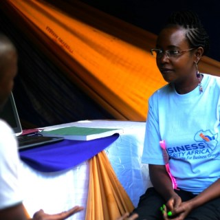 Business Integrity Africa Chief Executive Ms Grace Wanjohi explains to a client how the conduct database works. Ms Grace has also come up with a crime reduction software dubbed 'Mulika Uhalifu' launched in Nakuru recently. [Picture: Benard Ogembo]