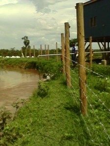 Solar plant structure and water pipe submerged in running river in   Sondu [Picture: Fred Deya]