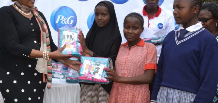 Nyeri First lady Margaret Karungaru with some of the school girls who benefited with free sanitary towels donated by Procter and Gamble Company recently. Photo Joseph Wambugu
