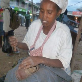 Eunice Chepyegon busy repairing a customer's shoe In Marigat. She has  embraced the job that is very rare among women. Picture :Mary Mwendwa