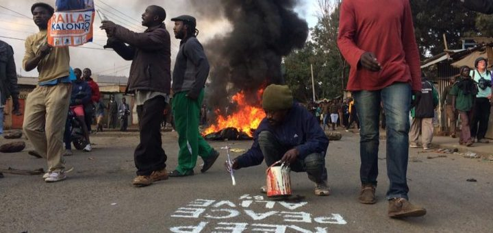 Solomon Muyundo (Solo7) , a peace crusader in Kibra slums paints the road during the August 2017 elections. He has been painting for many years to promote peace. Picture: File