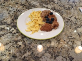 Saucy Cinna-cakes with scrambled eggs and fresh blueberries!