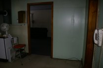 A shot of the wall between the kitchen and the living room that will be going bye bye.