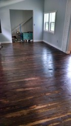 Here is the new pine added to the front of the house in the entry/dining room. Dark walnut stain by minwax on pine floors.