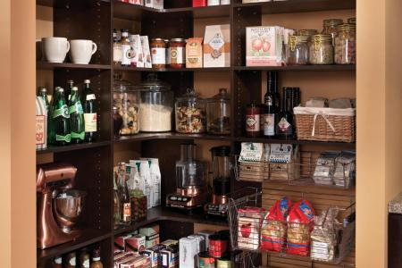 an attractive well ized pantry space can serve double duty as both storage and a display area.