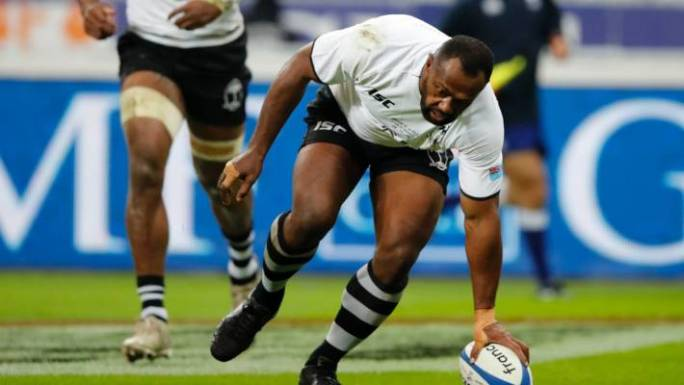 Fiji's Vereniki Goneva touches down for a try that was disallowed on video review.