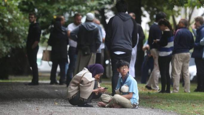 Mosque attendees in Hagley Park after shooting.