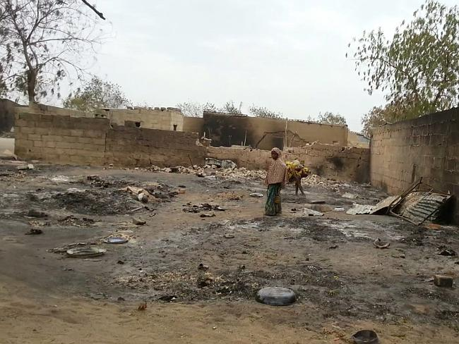 This photo from April 2013 shows a young girl standing amid the burned ruins of Baga, Nig