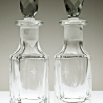 Pair of very old, very well-cared for jewel stoppered glass star bottles.