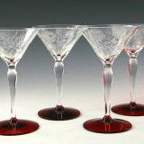 High quality Art Deco cocktail stemware in crystal with applied ruby feet and open rose floral etching.