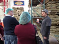 Visitors liked taking pictures up against the stacks of coffee in burlap bags.