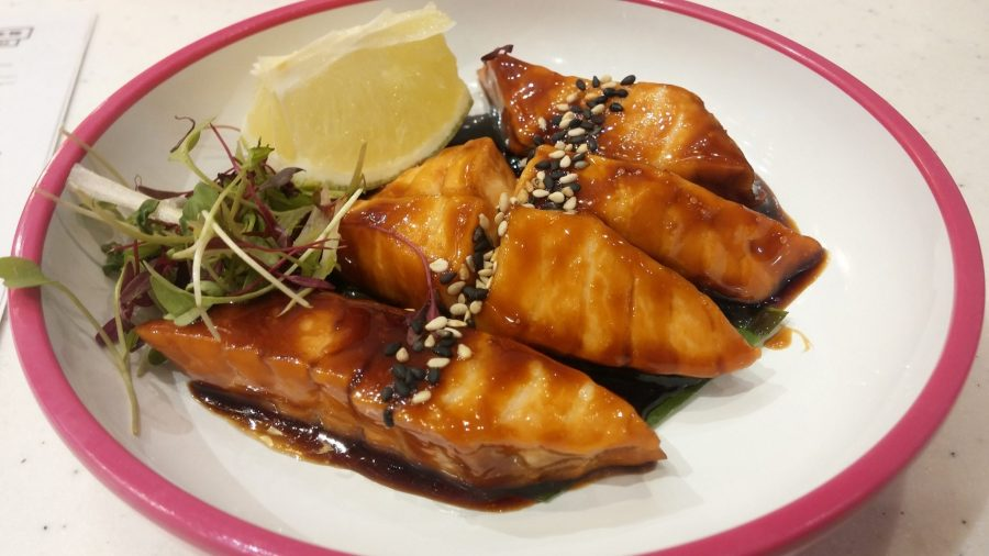 grill hot salmon steaks glazed in sweet soy sauce
