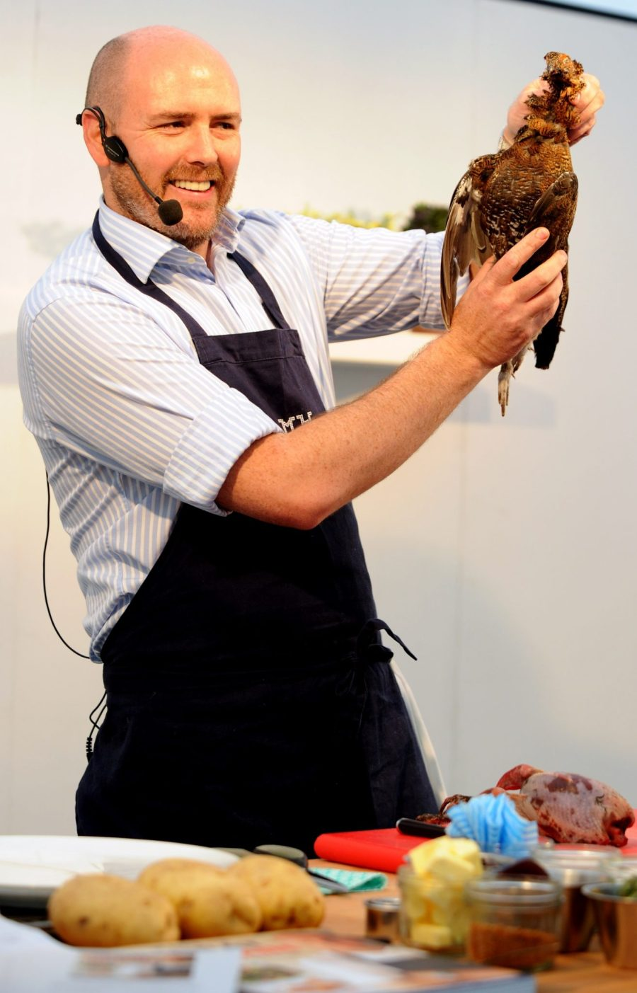 The annual Bolton Food and Drink festival drew in a large crowd this Sunday where revellers soaked up the atmosphere. Star attractions on the day were chefs John Torode of Masterchef fame and Aiden Byrne from the Manchester House restaurant. Chef Aiden Byrne gives a demo on how to cook Grouse. Picture by Paul Heyes, Sunday August 24, 2014.