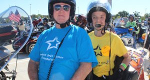 Brain tumor survivor Daniel (right) is ready to ride in St. Louis. (Photo: Ride For Kids)