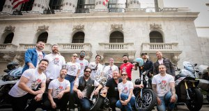 The celebrity riders for Kiehl's 7th Annual LifeRide pose in front of the New York Stock Exchange, August 3, 2016. (Photo: Jean-Francois Musy)