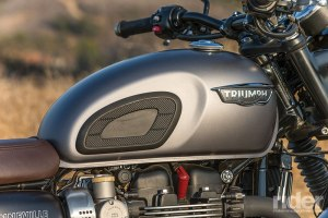 Triumph's steel tank is reminiscent of the 1960s version, complete with knee pads.