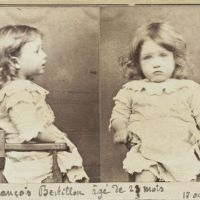 Adorable mug shot of 19th century pear-nibbling toddler