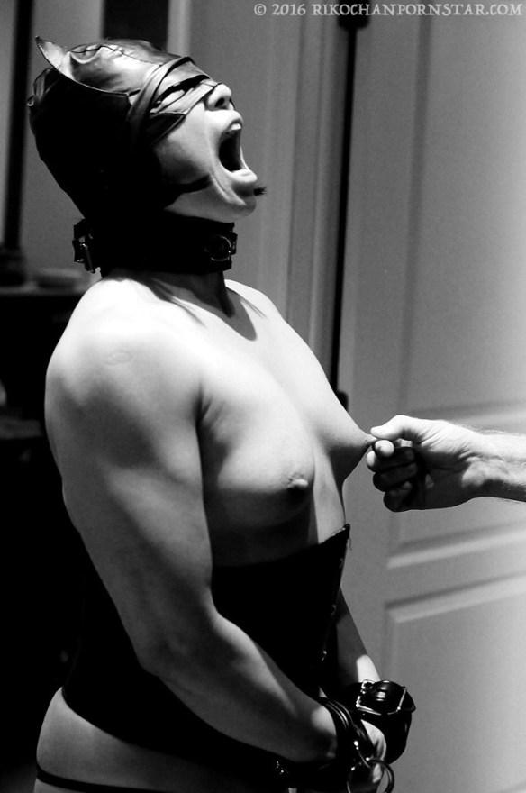 Sub Rikochan in bondage, getting her nipple pinched