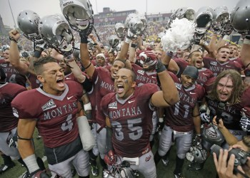 FILE - In this Aug. 29, 2015 file photo, Montana's Chris Parker (4) and Kendrick Van Ackeren (35) celebrate with teammates after their 38-35 win over North Dakota State in an NCAA college football game in Missoula, Mont. North Dakota State will try to get revenge for their season-opening setback when they host Montana in Fargo on Saturday, Dec. 5, 2015. NDSU is on a quest for their fifth straight Football Championship Subdivision title. (AP Photo/Rick Bowmer)