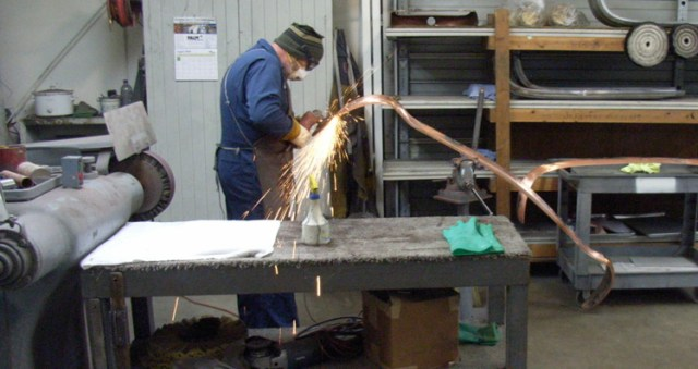 First of many steps in the metal finishing process prior to the final layer of chrome plating