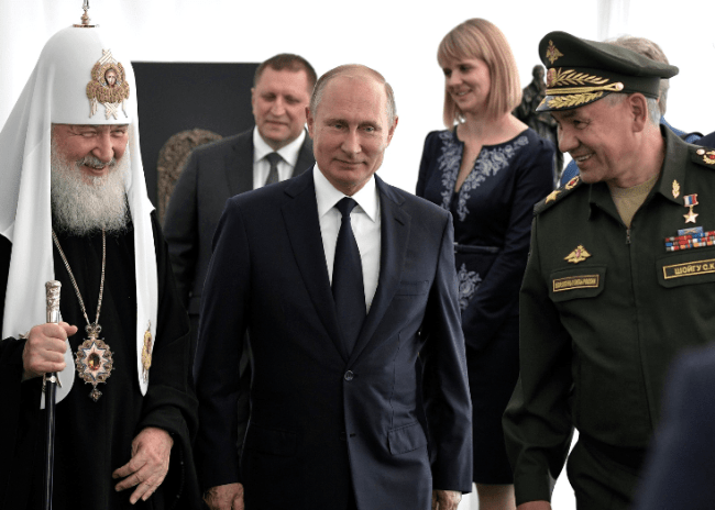 September 19, 2018 Patriarch, President, and Defence Minister Sergei Shoigu at the consecration ceremony for the foundation stone of the main church of the Armed Forces at Patriot Park