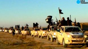 ISIS in their by Dutch government sponsored Toyota trucks (foto USA Today)